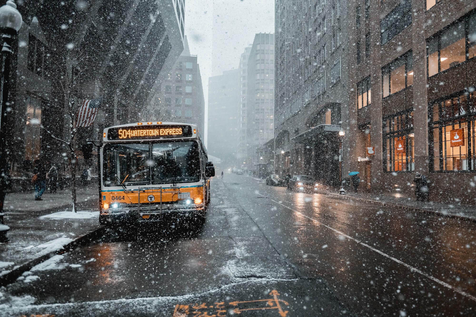 a bus in a snowing city