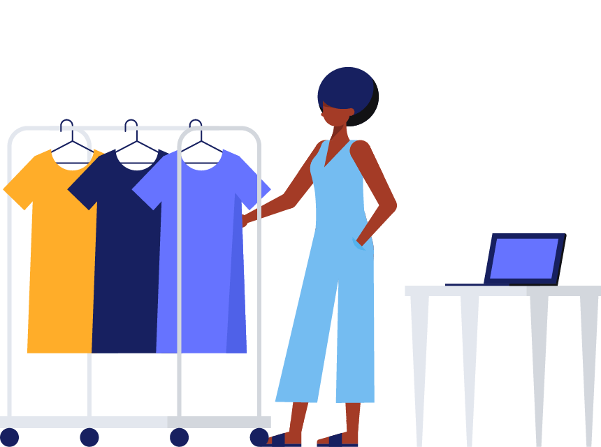 A woman stands betweena laptop and a rack of hanging dresses.